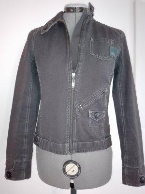 Eine coole Stoff Jacke in Militär-still,in dunkel-grau-blass Farbe /Baumwolle.