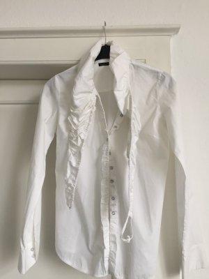 Eine weiße Bluse von Girbaud