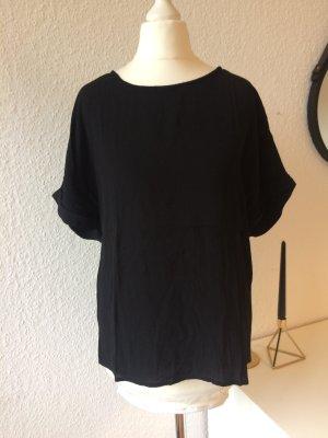 Einfaches schwarzes Shirt mit besonderem Detail   Schwarz