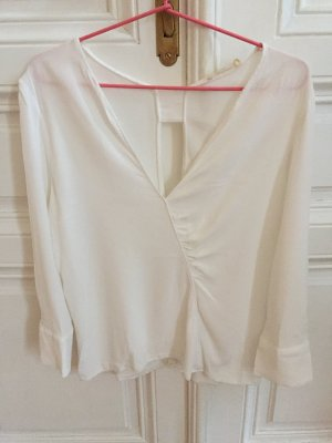 Elegant weiße, seidenartige Bluse