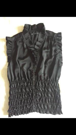 Elegante ärmellose Bluse mit Rüschen