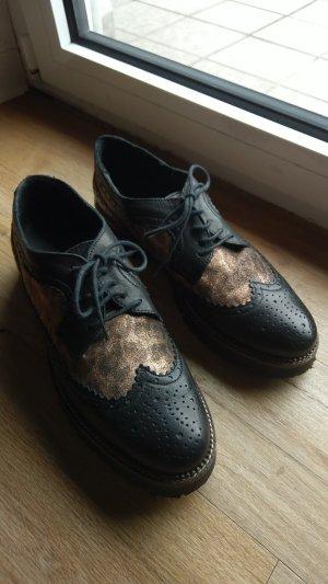 Zapatos brogue negro-color rosa dorado