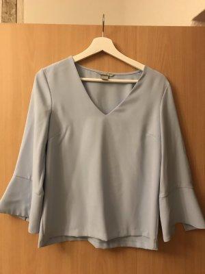 Elegante Bluse mit ausgestellten Ärmeln und V-Ausschnitt