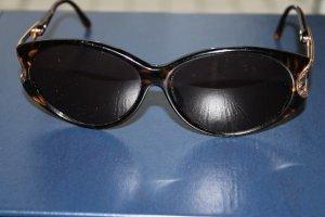 Elegante, dunkelbraune Sonnenbrille von Dior mit stabilem Etui und Schutzhülle