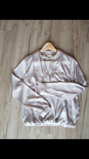 Elegante goldene Bluse