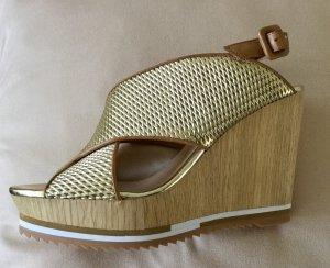 Elegante goldene Bruno Premi Plateau Sandaletten in Leder Größe 38