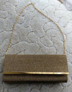 Elegante goldene clutch