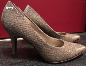 elegante goldene Pumps