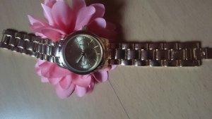 Elegante goldene Uhr