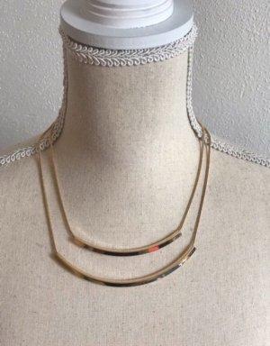 Elegante goldfarbene Halskette