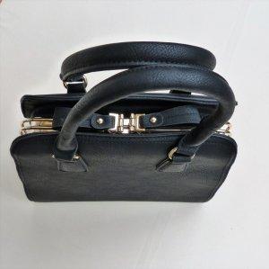 Elegante Handtasche - schwarz mit goldenen Details