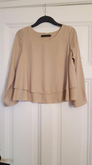 elegante hellbeige Bluse mit Einsatz
