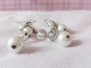 elegante Ohrringe mit Perlen