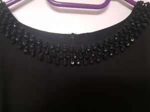 elegante schwarze Bluse mit Perlen