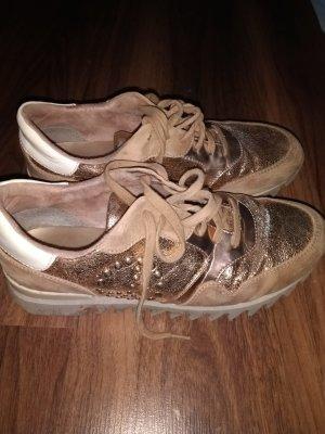 Elegante Sneakers in gold