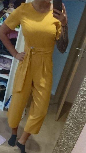 Tuta giallo-oro-arancione chiaro
