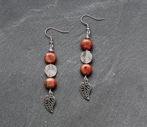 Dangle silver-colored-brown metal