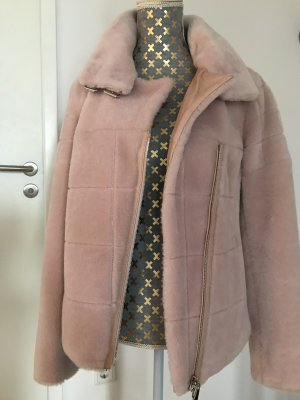 Escada Veste en fourrure rose