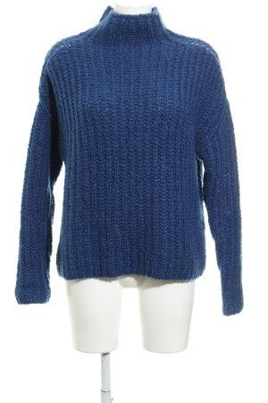 Essentiel Antwerp Jersey de lana azul modelo de punto flojo look Street-Style