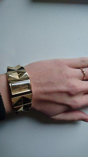extravagante & stylische goldene Uhr