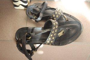 Sandalias con talón descubierto negro Cuero