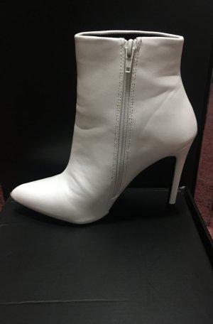 Botas con tacón blanco-negro