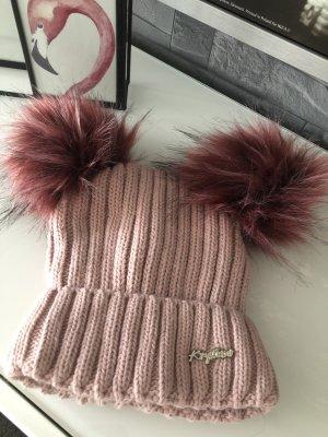 Chapeau en tricot vieux rose
