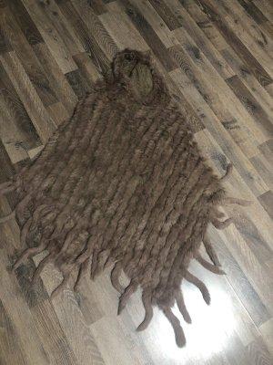 Smanicato di pelliccia bronzo-color cammello