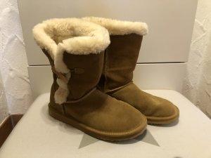 Botas de nieve coñac-blanco puro