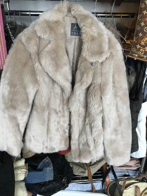 Giacca di pelliccia beige chiaro