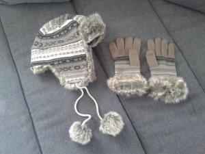 Fellmütze und Handschuhe