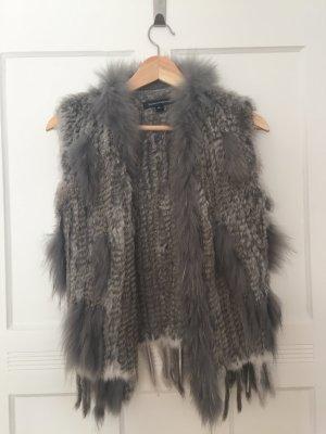 Smanicato di pelliccia grigio-grigio chiaro