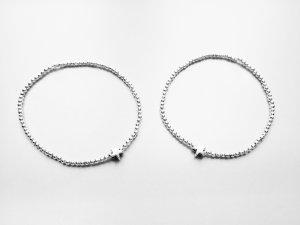 filigranes Armband mit silberfarbenen Perlen und kleinem Sternchen