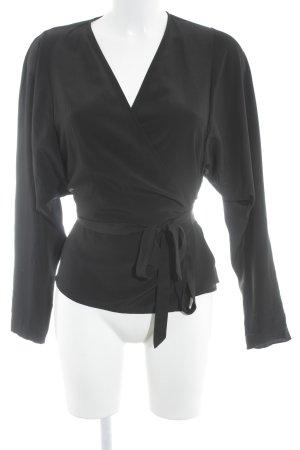 Filippa K Wikkelblouse zwart minimalistische stijl