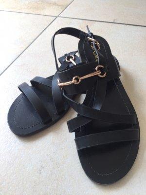 Sandalo con cinturino e tacco alto nero-oro Finta pelle