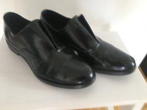 Fläche Lederschuhe in schwarz