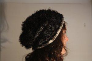 Sombrero de punto negro-crema tejido mezclado