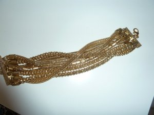 Armlet gold-colored synthetic material