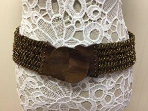 Cinturón color bronce