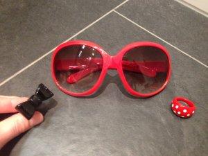 Flippiges Set aus Sonnenbrille und passenden Ringen