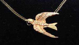 Fossilkette mit Roségold- Vogelanhänger