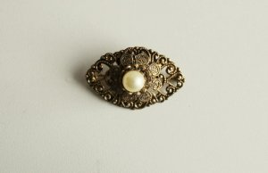 Broche color bronce