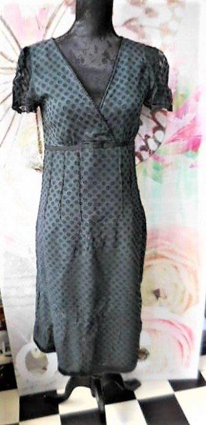 FRANSA Gr. 36/38 leichtes Sommerkleid schwarz mit Punkten - Untergrund etwas heller als die Punkte sehr guter Zustand seitl. Reissverschluss, aussen schwarze matte Viskose (wirkt optisch wie Seide) sehr dünn leicht transparent, dunkelgraues Futter das dur
