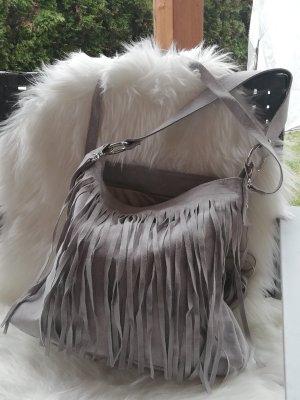 Bolso de flecos color plata Cuero
