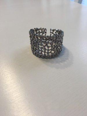 Bracelet de bras argenté-gris clair