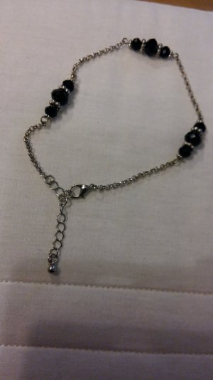 Fußkette in schwarz/silber