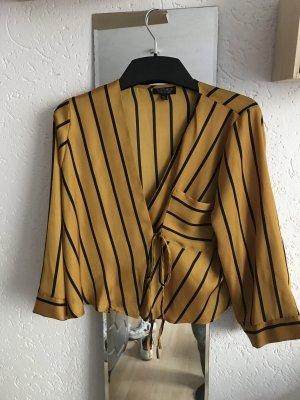 Gelb schwarz gestreifte Bluse im Wickelstil