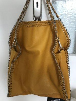 Gelbe Lederhandtasche mit Kettennähten