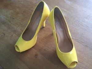 Andrea Conti Hoge hakken geel