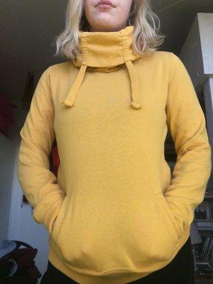 Gelber Rollkragen